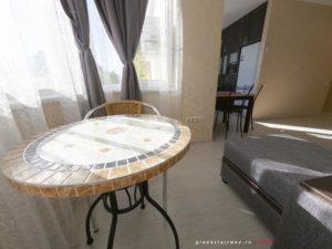 Совмещенный с гостиной балкон